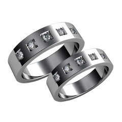 A pair of gold diamond wedding bands - 1
