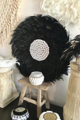 Black feather and shells wall decor