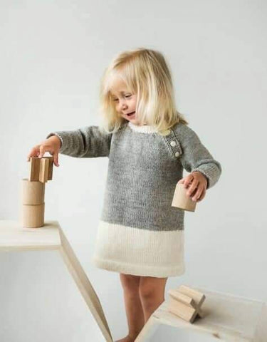 Modern knitted baby girl dress