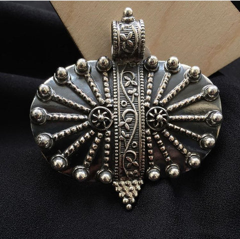 Tribal oval silver pendant