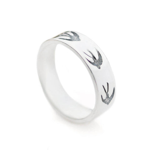 Silver ring band with tiny swallows