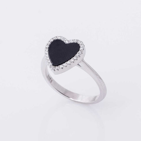 Silver ring with black heart