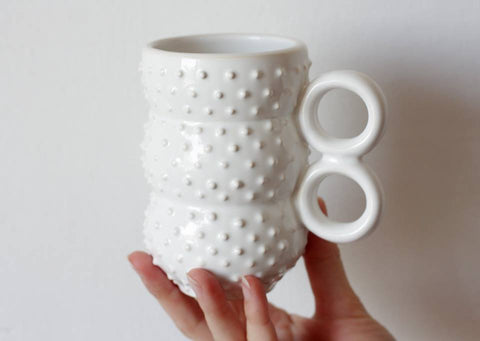 White spiky ceramic cup