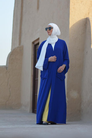 What to Wear Under a Blue Open Abaya with Pockets