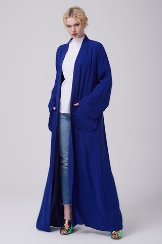 What to Wear Under a Blue Open Abaya with Frilled Pockets