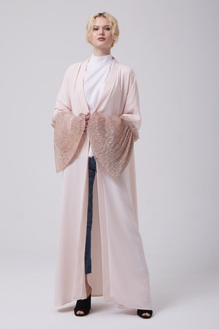 What to Wear Under a Pink Open Abaya with Oversized Sleeves