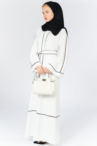 What to Wear Under a White and Black Open Abaya with Belt