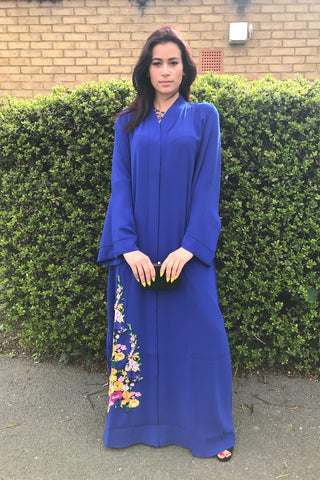 Reasons to Wear an Abaya Blue with Flowers on Hemline