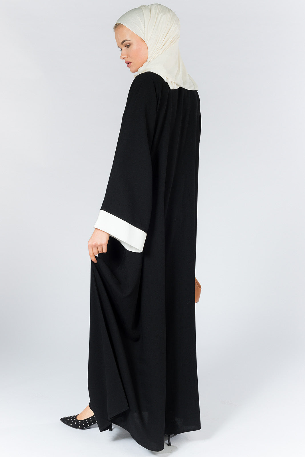 Closed Black Abaya with White Details in Nida