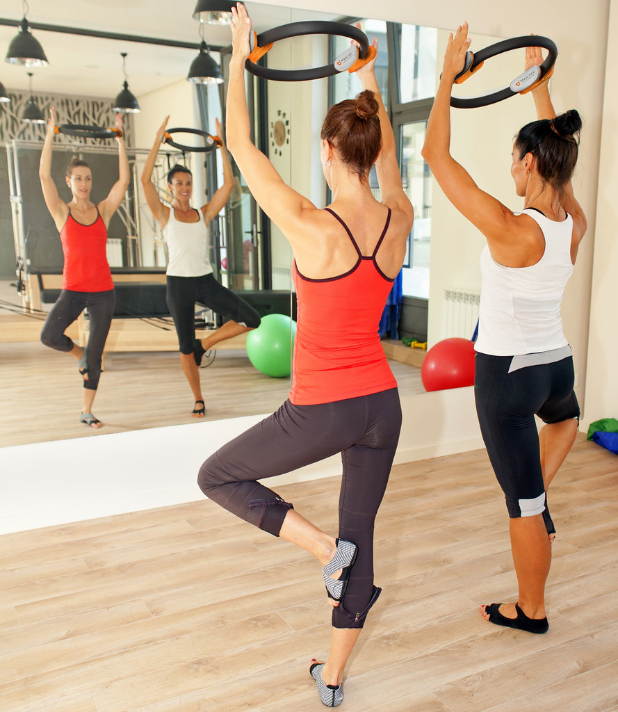 two girls using the Pilates Ring Magic Fitness Circle