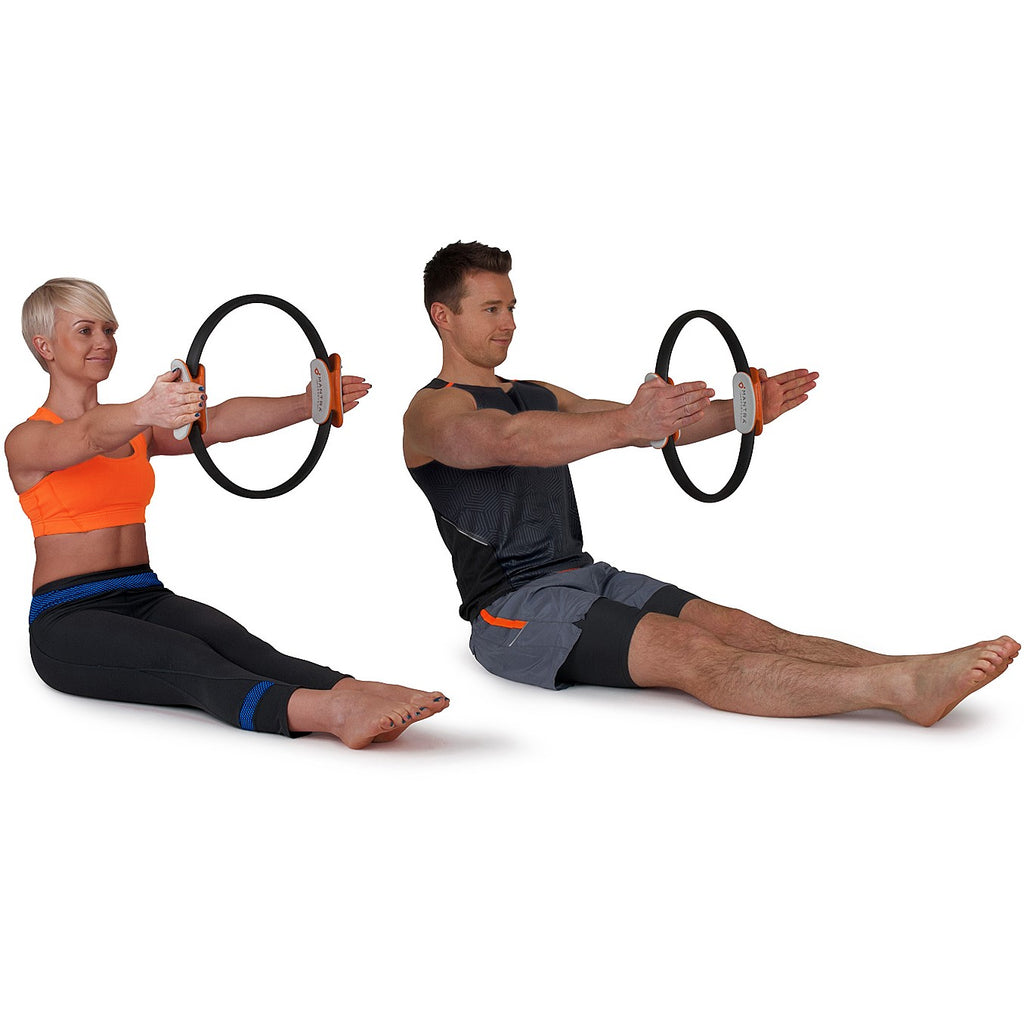 boy and girl using the Pilates Ring Magic Fitness Circle