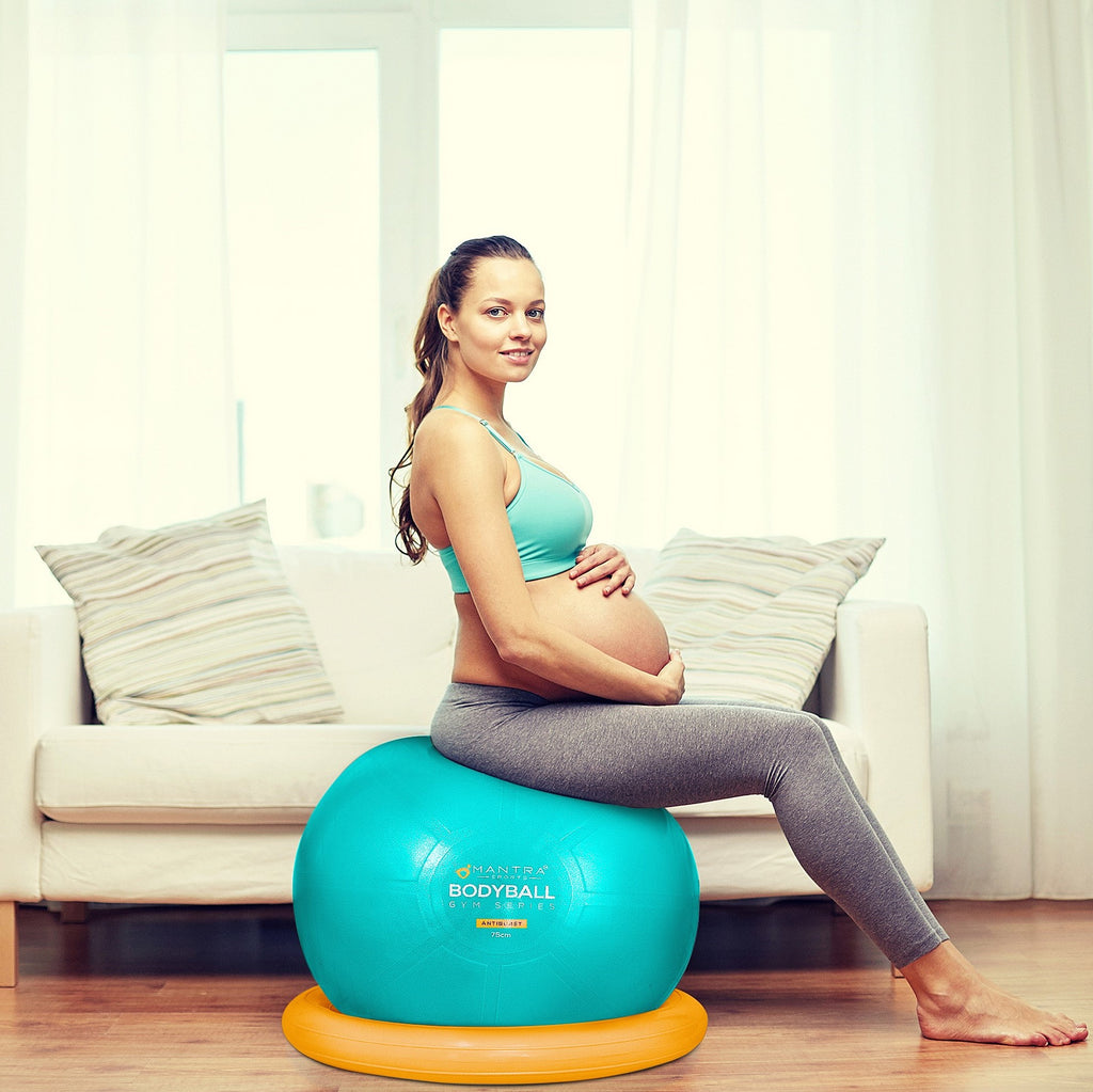 a pregnant woman using the exercise ball