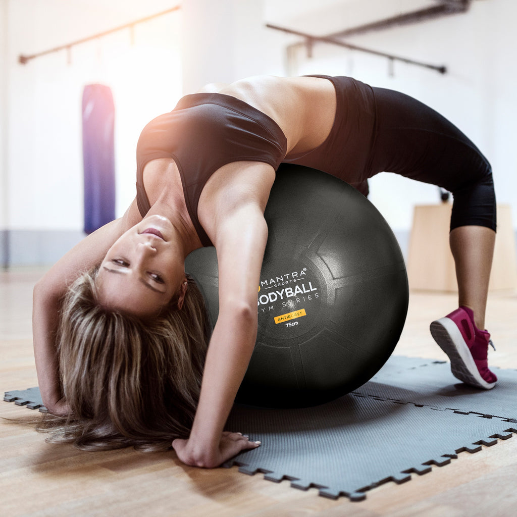 a beautiful girl using the exercise ball chair for exercise