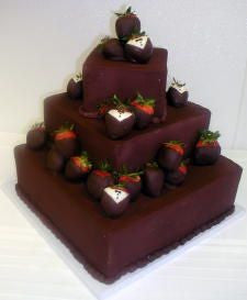 Tuxedo Strawberries on Chocolate Cake