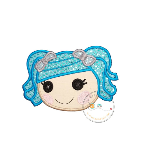 Large lala doll face with blue hair. Iron embroidered fabric applique