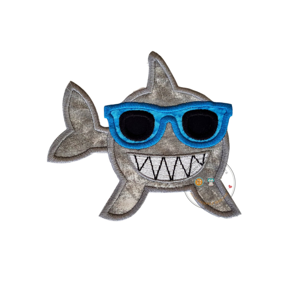 Smiling, gray-wash shark iron-on applique with big, white embroidered teeth