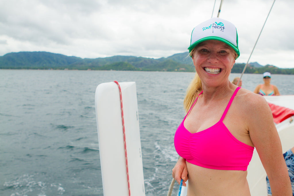 Smiling woman in costa rica on sailboat