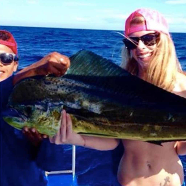 Woman with giant fish she caught in Costa Rica