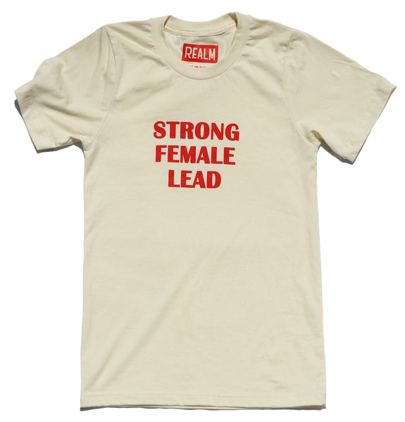 "Strong <br> Female <br> Lead <br> <img src=""https://cdn.shopify.com/s/files/1/1435/9366/t/3/assets/realm-lips.png?1053709037421936823"" alt=""lips""><br> Off-white and Red Shirt"