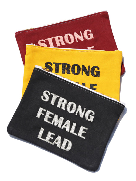 "Strong <br> Female <br> Lead <br> <img src=""https://cdn.shopify.com/s/files/1/1435/9366/t/3/assets/realm-lips.png?1053709037421936823"" alt=""lips""> <br> Clutch"