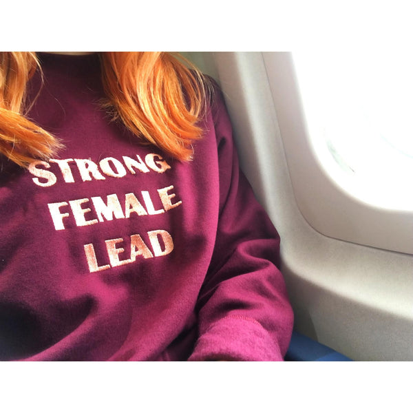 "Strong <br> Female <br> Lead <br> <img src=""https://cdn.shopify.com/s/files/1/1435/9366/t/3/assets/realm-lips.png?1053709037421936823"" alt=""lips""><br> Sweatshirt"