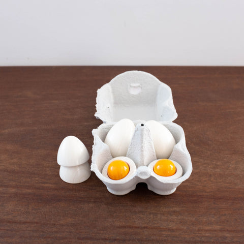 Four Wooden Eggs in Cart