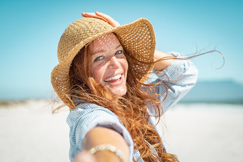 woman wearing sunhat and long sleeved shirt