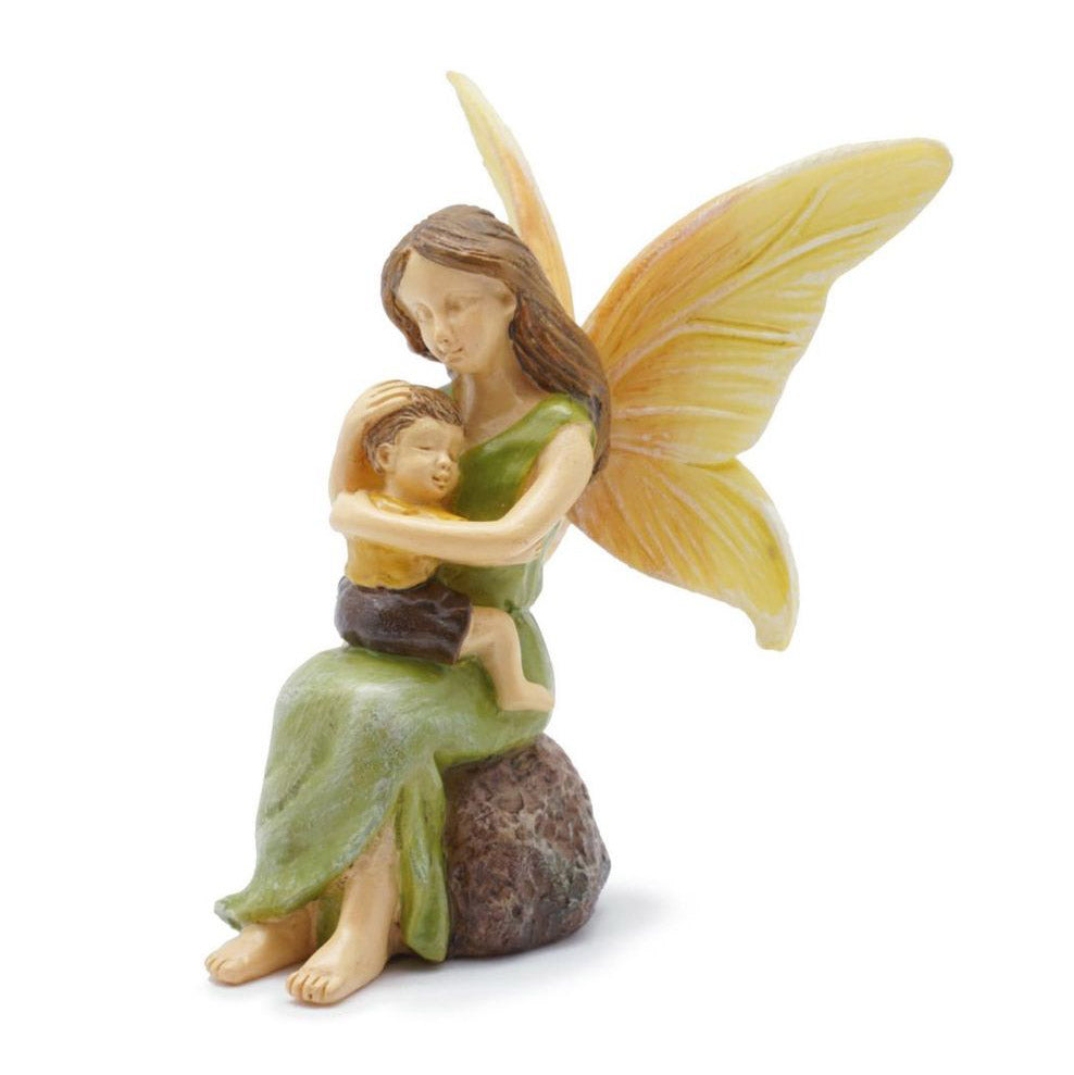 The woodland knoll fairy garden miniature Mom is hugging her cherished fairy boy.