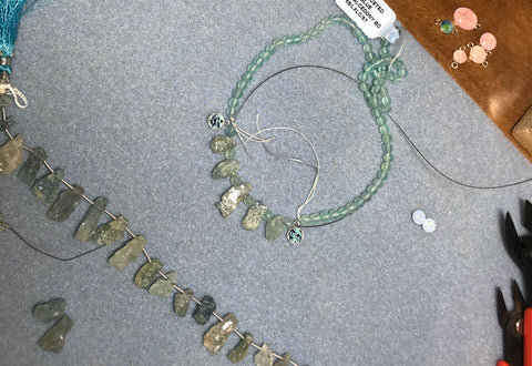 ovarian cancer awareness necklace in process of being designed and made