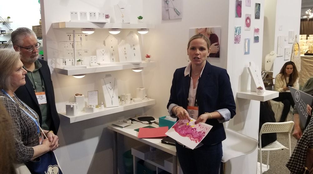 nikki zazzali presenting in her booth at las vegas market on the meet the makers tour