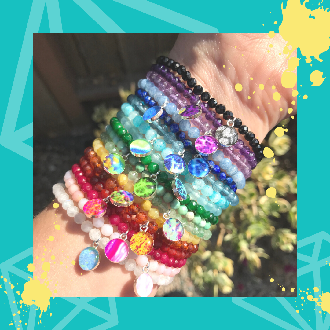 arm full of stretch bracelets in a rainbow of colors for 17 different disease causes