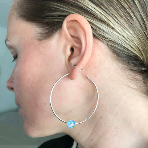 Nikki wearing the power hoop earrings for Alzheimer's awareness