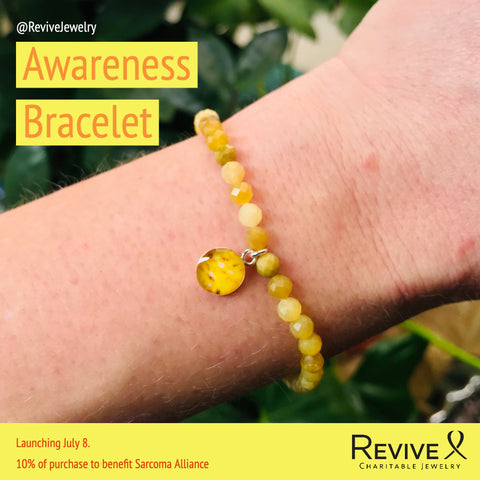sarcoma alliance awareness bracelet on wrist