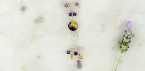 close up of amethyst jewelry collect hope necklace for lymphoma awareness and research