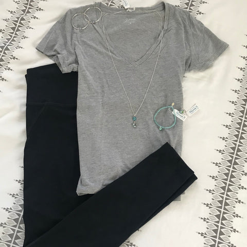 athleisure outfit with black leggins and gray tee shirt paired with teal jewelry for ovarian cancer, Alzheimer's and infertility awareness