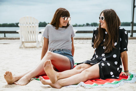 girls sitting on the beach talking