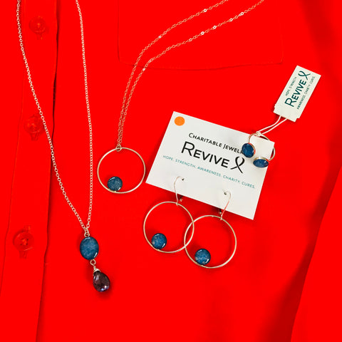 close up of orange shirt with blue jewelry for multiple sclerosis awareness