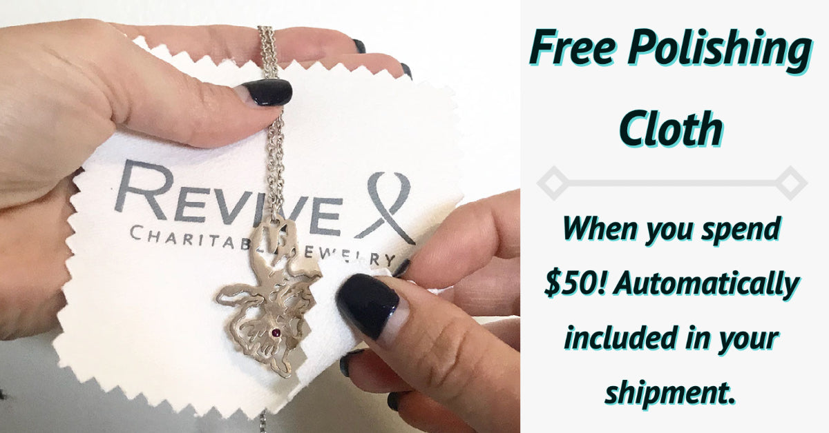 necklace being cleaned with revive jewelry polishing cloth. free polishing cloth when you spend $50 automatically included in your shipment.