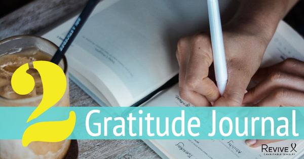 hand writing in book 2 gratitude journal