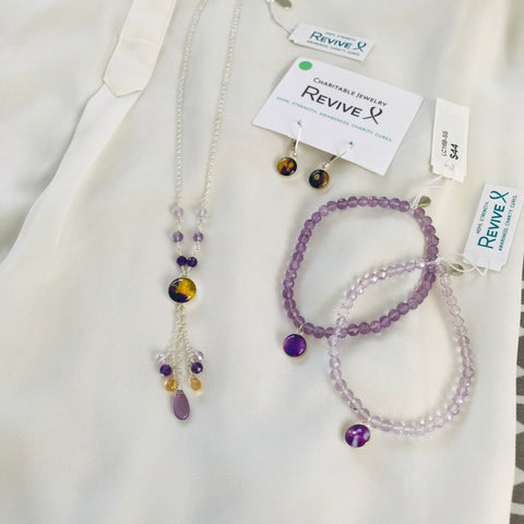 close up of purple and yellow jewelry for lymphoma, lung cancer and pancreatic cancer awareness
