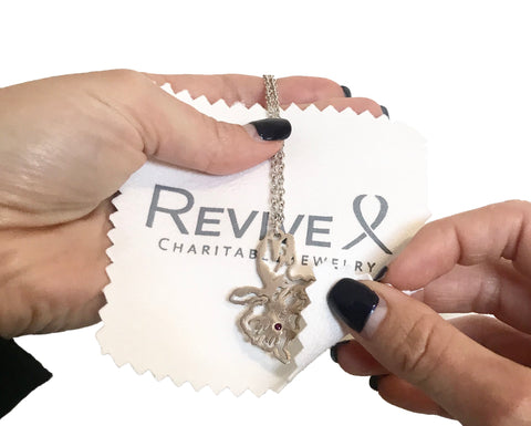 cleaning jewelry with a custom Revive Jewelry polishing cloth