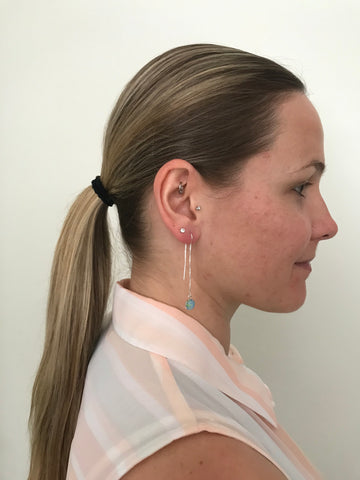 side pony tail and thread of hope earrings for alzheimer's awareness