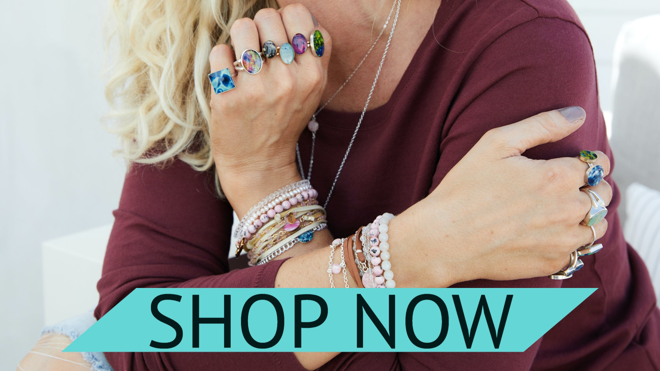 model wearing stacked up rings and bracelets for a cause