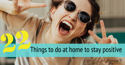 Woman smiling with sunglasses and hands making peace signs 22 things to do at home to stay positive