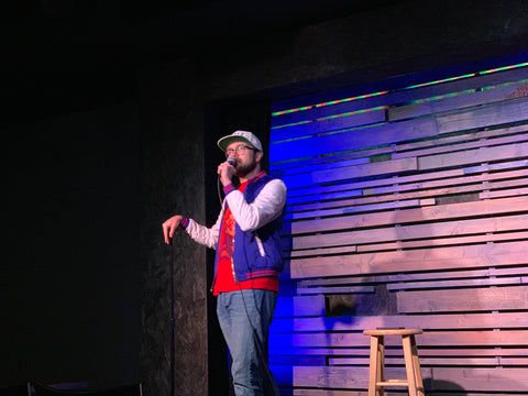 Zack Hillman doing stand up at a comedy club