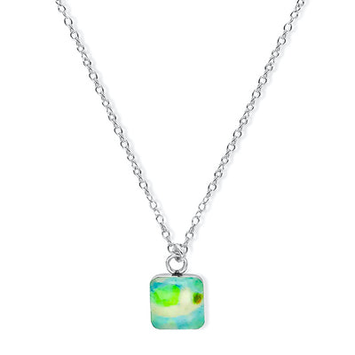 close up of square pendant chain necklace for Alzheimer's awareness gives back to research