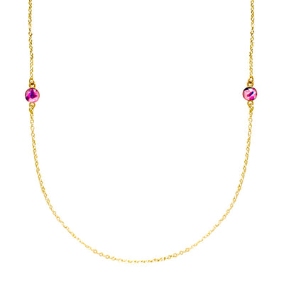 close up of long chain necklace with pink resin pendants for breast cancer awareness that give back