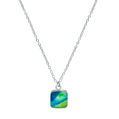 close up of square blue and green pendant chain necklace for diabetes awareness gives back to research