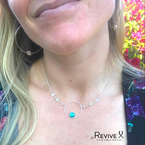 Nikki wearing the fertile soul necklace for infertility