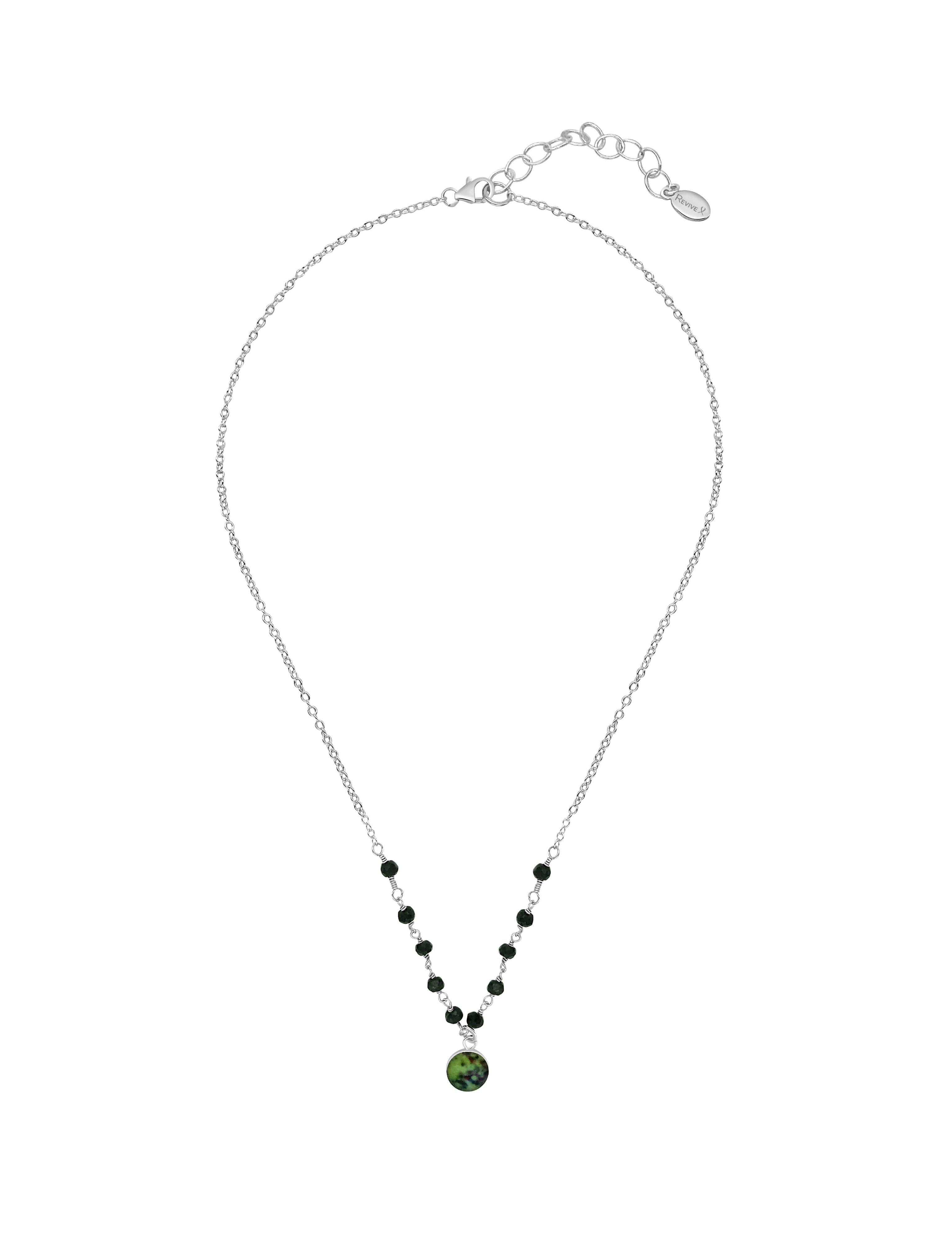 16 inch to 18 inch adjustable sterling silver chain with small black spinel stones across the front and a small round pendant hanging from the center of a melanoma cell image in resin